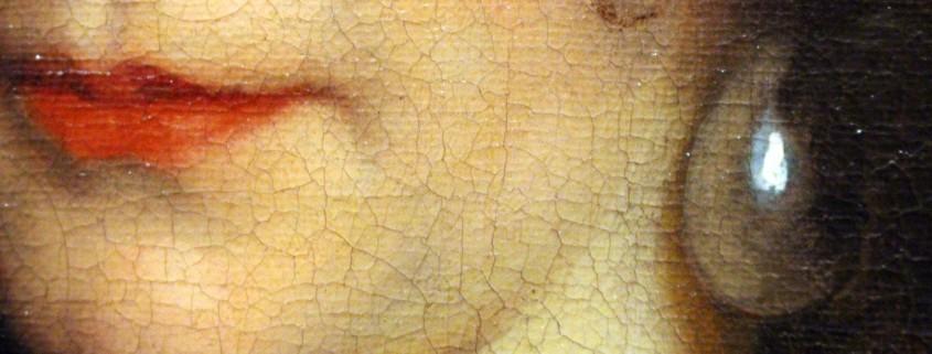 un viso di un dipinto, pieno di rughe per il tempo passato